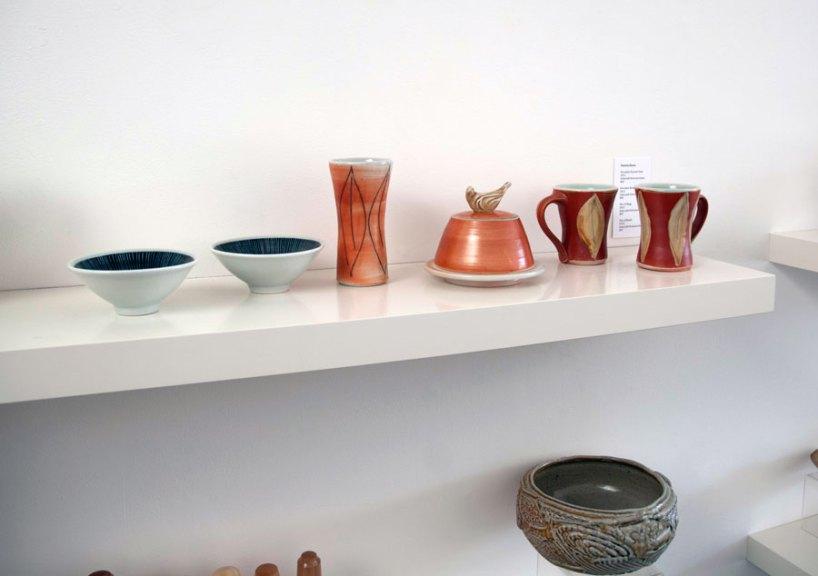 Pat Burns, Pair of Porcelain Bowls, Faceted Vase, Porcelain Butter Dish, Pair of Mugs, 2013. Soda/salt-fired porcelain, Madison Metro photograph