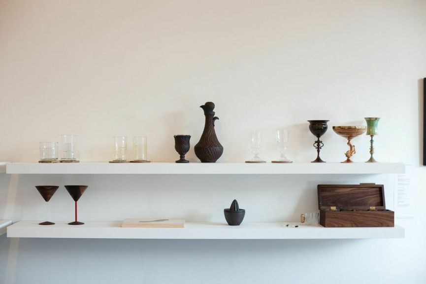 (top, l-r) Nate Cotterman, Low Ball and High Ball Cube Glasses; James Vella, Collins Glasses; A. Blaire Clemo, Decanter and Cup; James Vella, Absinthe Glasses; Wyatt Amend, Emerald Cup, Venetian Dolphin and Blue + Gold Cup; Bari Ziperstein, Hexagon and Finnish Coasters. (bottom, l-r): David Rasmussen Design, Wood Martini Glass, black walnut and acrylic; Treeline Woodworks, Golden State Cutting Board, reclaimed wood; Lindsay Oesterritter, Juicer, iron-rich stoneware, wheel thrown press mold, woodfired; Neptune Glassworks, Glass Stir Sticks, glass; Conveyor Cups with Walnut Box, blow-molded and hand finished glass with brass handle and walnut