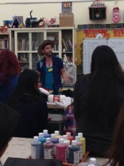 Zac teaching crochet to Fairfax 3-D Sculpture students