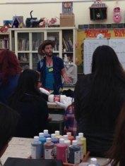 Zac teaching crochet to Fairfax 3-D Sculpture students