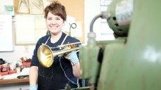 Heather Sessler holds a finished Monette trumpet. Mark Markley photograph