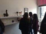 Students admiring Wyatt Amend's ceramic goblets