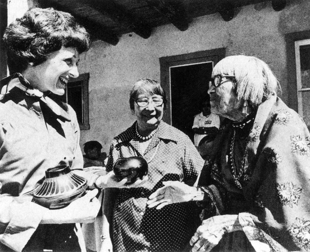 Joan Mondale receiving pottery from famed San Ildefonso Pueblo potter Maria Martinez, 1977