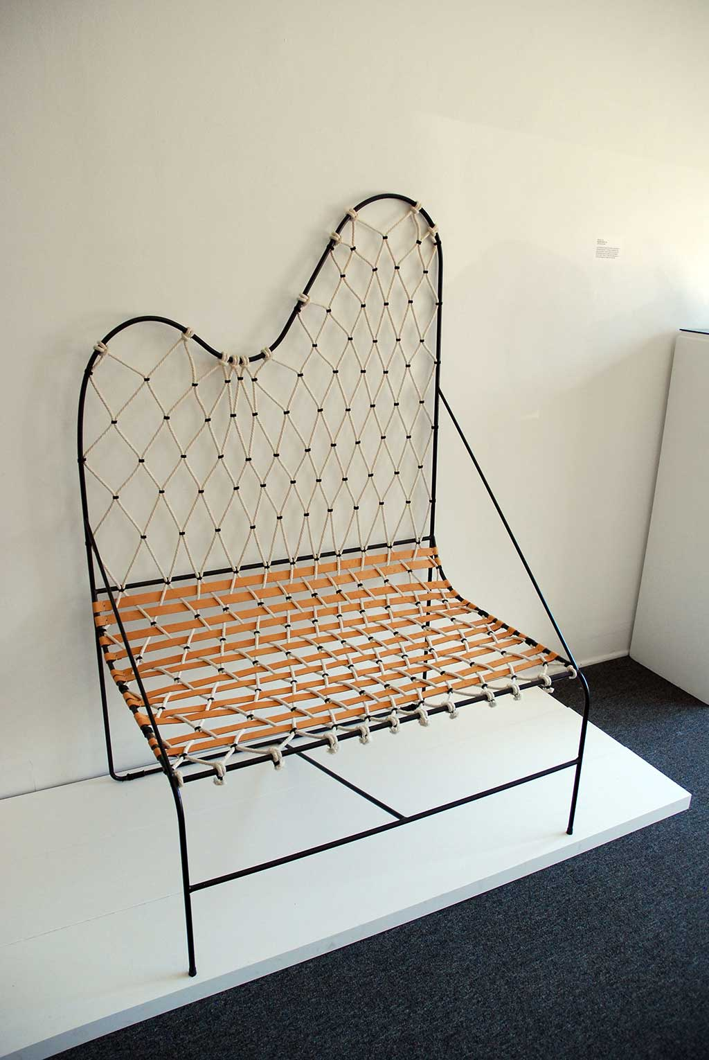 Tanya Aguiñiga, Round Hammock Settee, 2012. Steel rod, leather, cotton rope