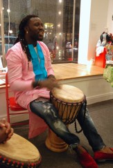Drummers teach the group call and response songs from Senegal.