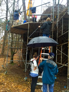 Sid and the crew filming Patrick Dougherty installation in rainy Greensborough, North Carolina.