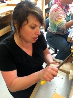 Lori Remmel filing her spoon
