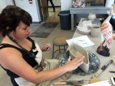 Lori Remmel is creating a dish that will relate to the bird she brought for inspiration