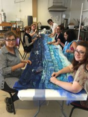 Terese Agnew and team putting the finishing touches on Current Flow, their banner dedicated to water issues