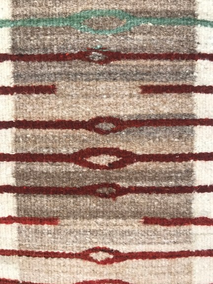 Sandra and Wence Martinez, Ojo de Agua, 2018. Hand spun Churro wool. Un-dyed natural creams, tans and brown. Red is aniline dyed by the artist. Flatweave tapestry. Excellence in Fibers IV, Craft in America