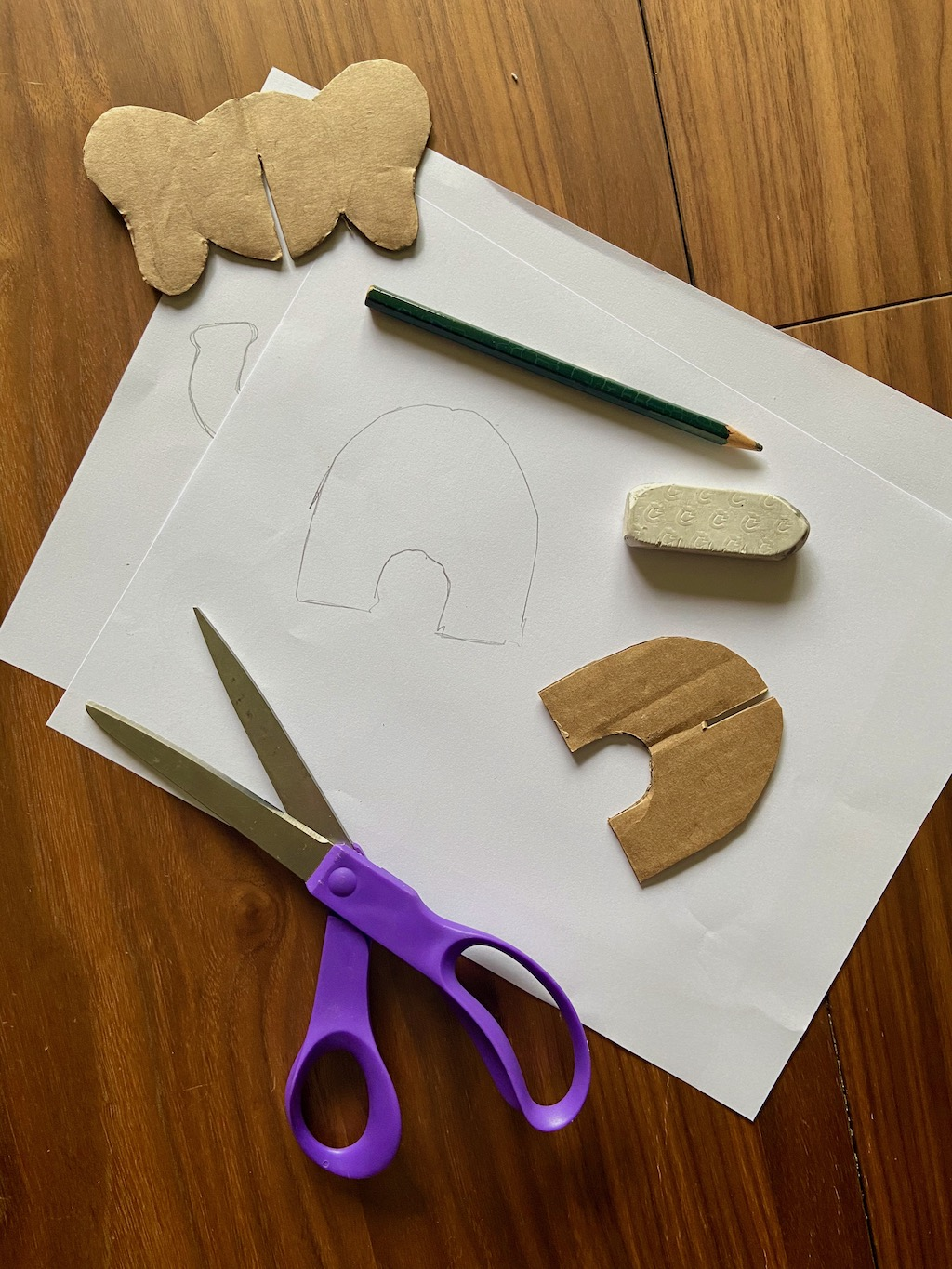 Draw the shape of a pair of legs for the elephant. You will make 2 of these pieces.