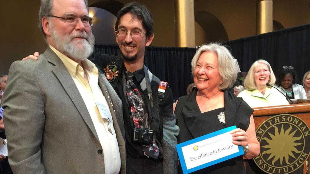 Patrick Benesh-Liu and Carolyn Benesh present an award at the 2016 Smithsonian Craft Show