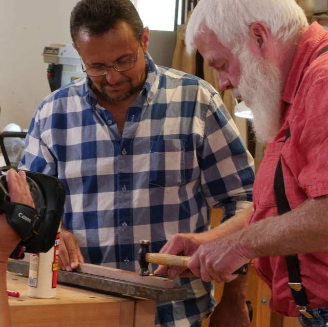 Instructor Paul Williams assists student at the Appalachian School of Luthiery's Culture of Recovery program in Hindman, Kentucky. Denise Kang photo. HARMONY episode of Craft in America