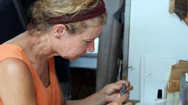 Gabrielle Gould works with bird feathers in her jewelry. Denise Kang photo. JEWELRY episode of Craft in America