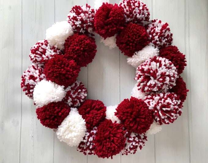Fun Valentines Party Ideas red and white pom pom wreath
