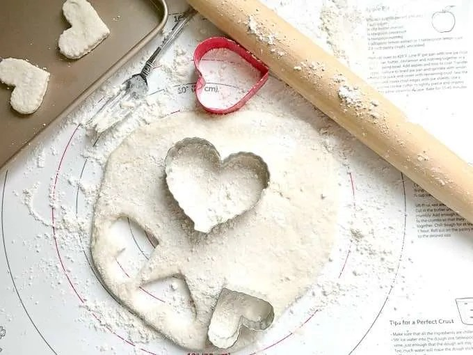 Fun Valentines Party Ideas rolling pin red heart cookie cutter biscuit dough