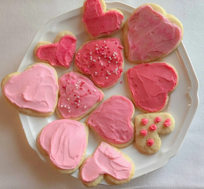 Fun Valentines Party Ideas red and pink heart shaped sugar cookies with frosting