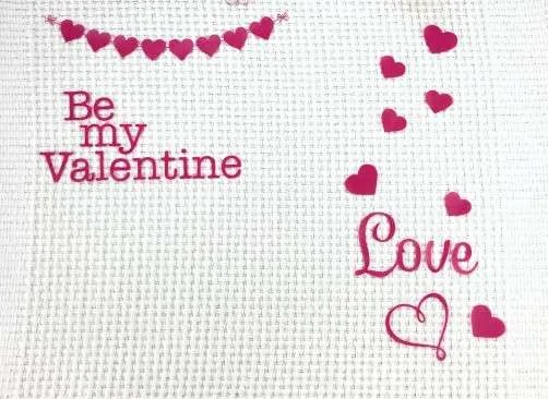 DIY Valentines Vinyl Placemat white placemat with red valentines hearts and love