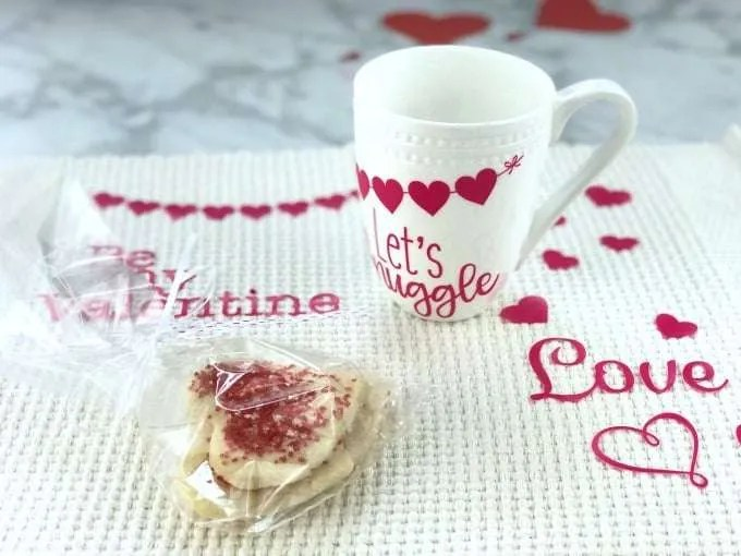 DIY Valentines Vinyl Placemat White placemat with heart cookies a white mug with red hearts and be my valentine and love in red vinyl
