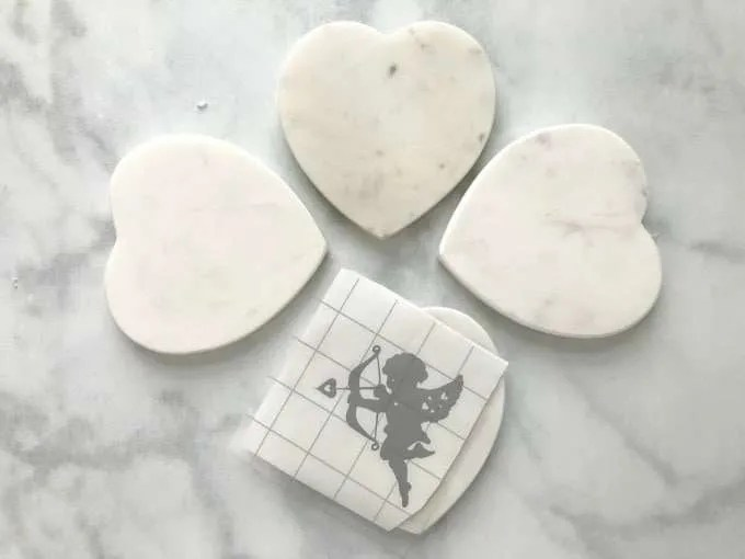 Valentines DIY Vinyl Coasters white heart shaped marble coaster with silver cherub vinyl decal and transfer tape