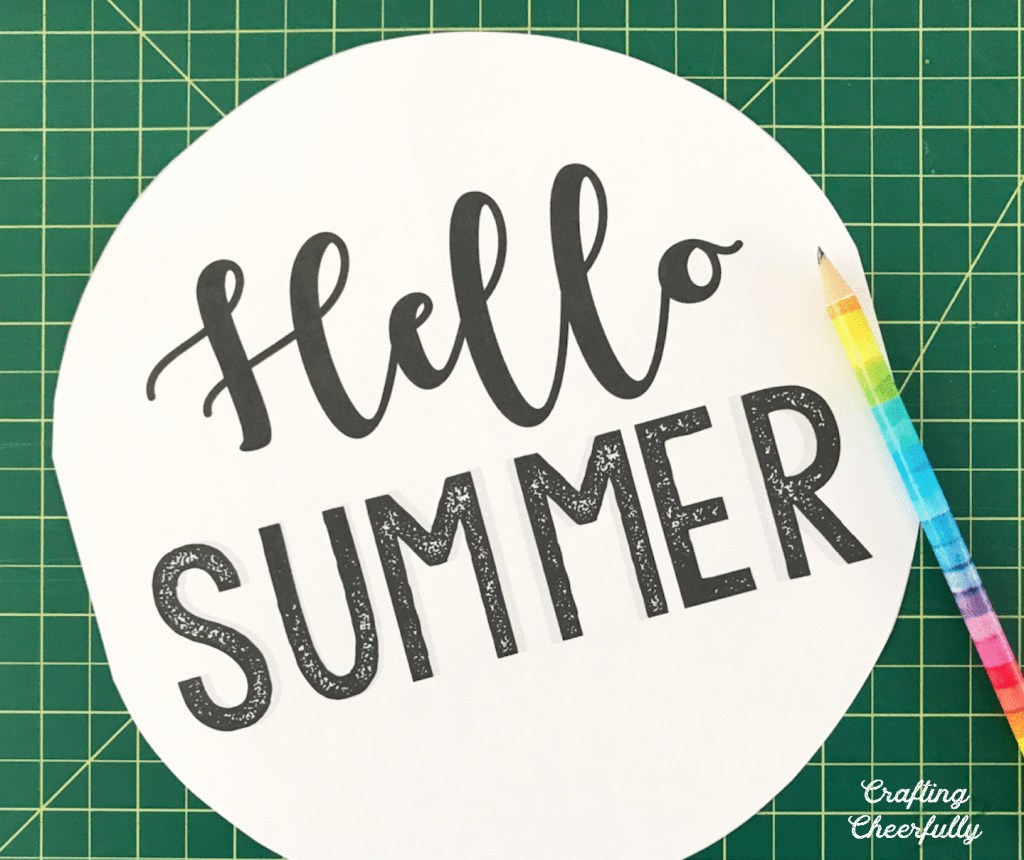 "Printable of the words ""Hello Summer"" and a pencil laying next to it."