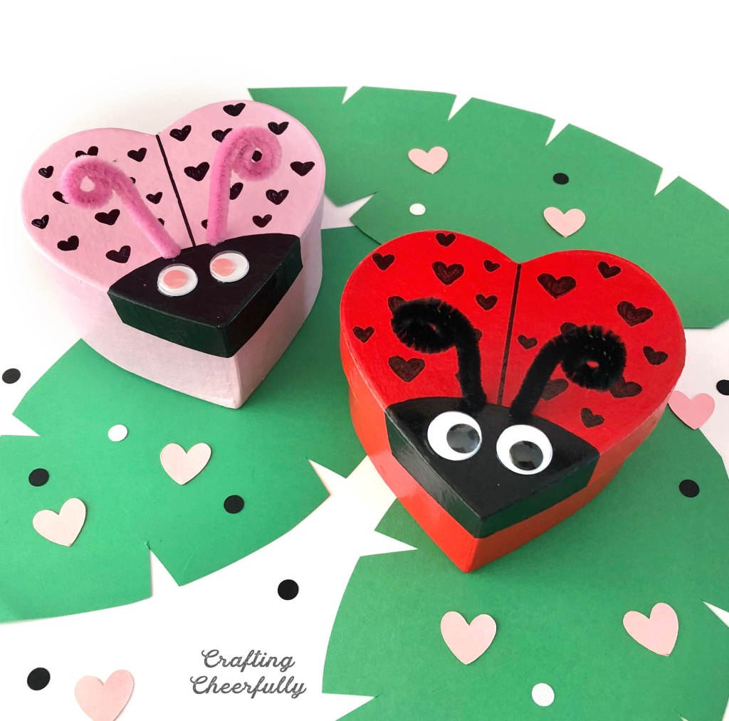 Heart shaped love bug boxes sit on paper leaves!