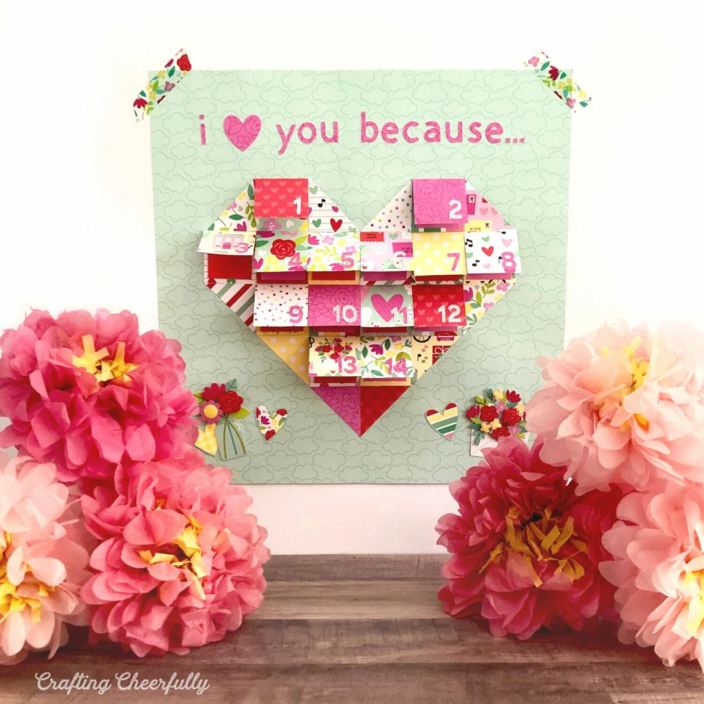 """""""I love You Because"""" countdown is taped to a white wall with paper flowers on the table."""