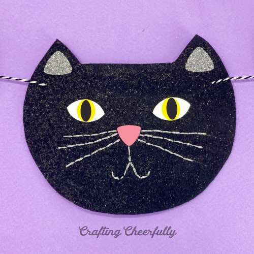 Black cat face made from felt