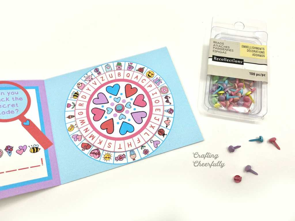 Attach Secret Decoder Wheel together using small colorful brads.