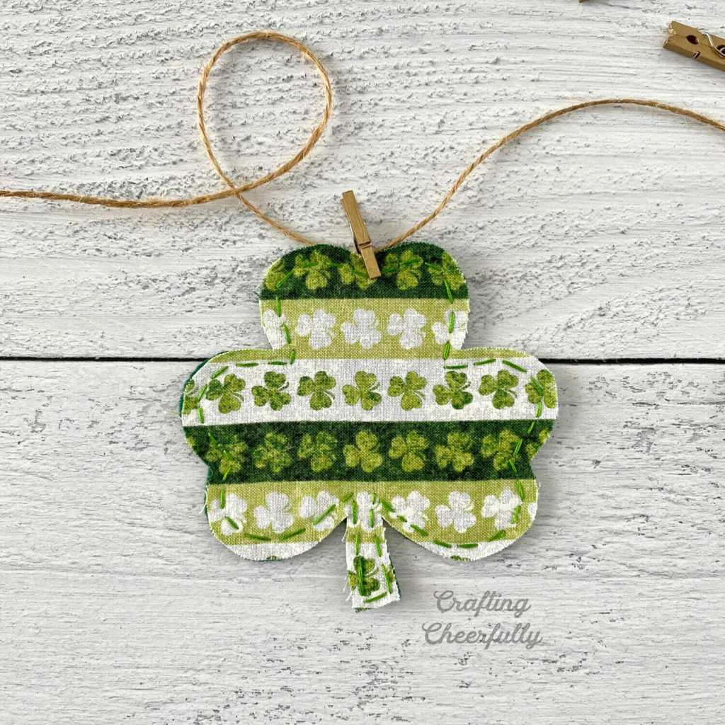 Fabric shamrock attached to twine with a mini clothespin.
