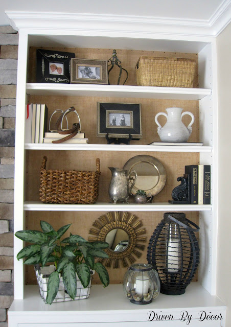 Burlap back bookcase decor