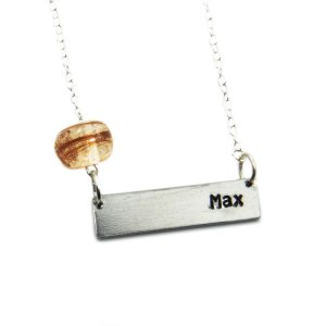 Cremation bead with a custom name charm