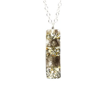 Pet ashes jewelry on a sterling silver chain
