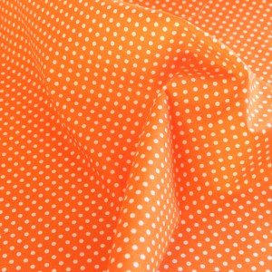 Small White Spots on Orange Fabric Material