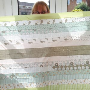 Kimberley displaying Darling Little Dickens jelly roll 49000 JR