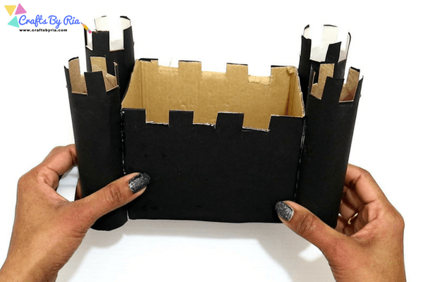 diy haunted house craft for kids-step6-stick paper rolls to the cardboard