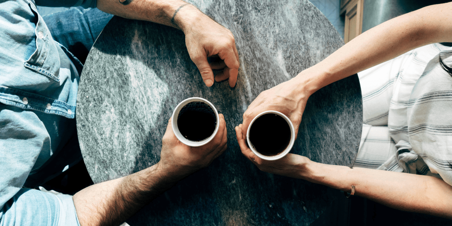 couple enjoying coffee at a table