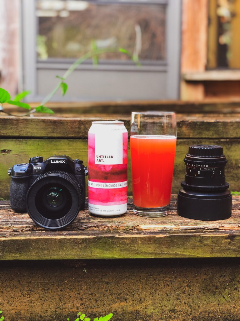 Camera gear and a glass of beer. (Pink Lemonade IPA by Untitled Art Brewing).