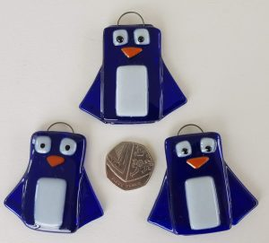 3 hand made glass penguins