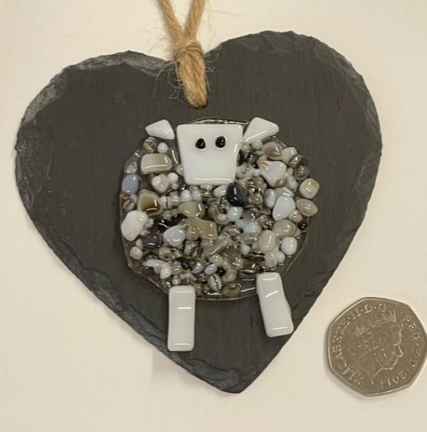 Glass sheep on a slate heart