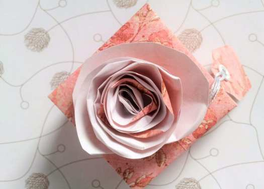 handmade pink paper box with paper rose on top