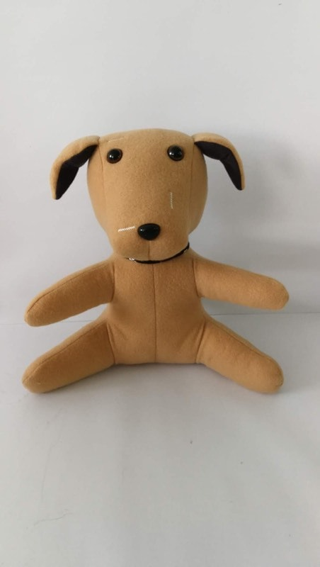 brown plush dog against a white background