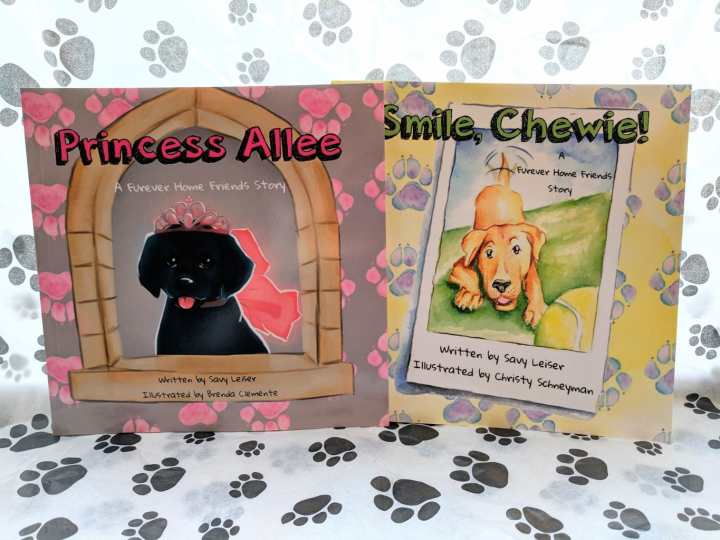 two books with a black dog and a brown dog on the covers