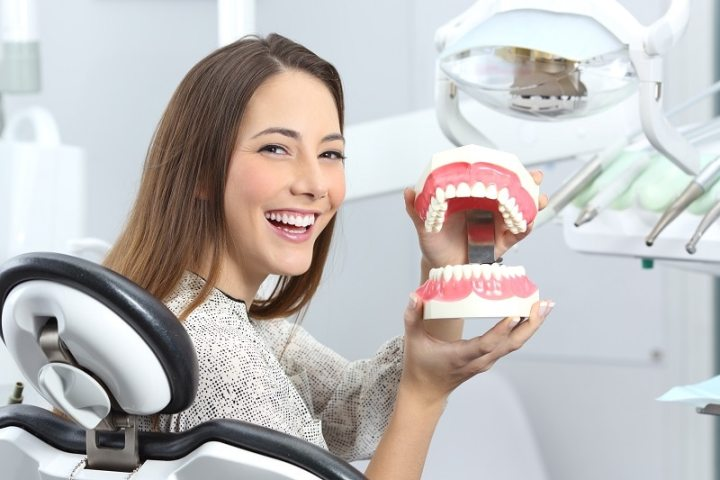woman with full dentures mold