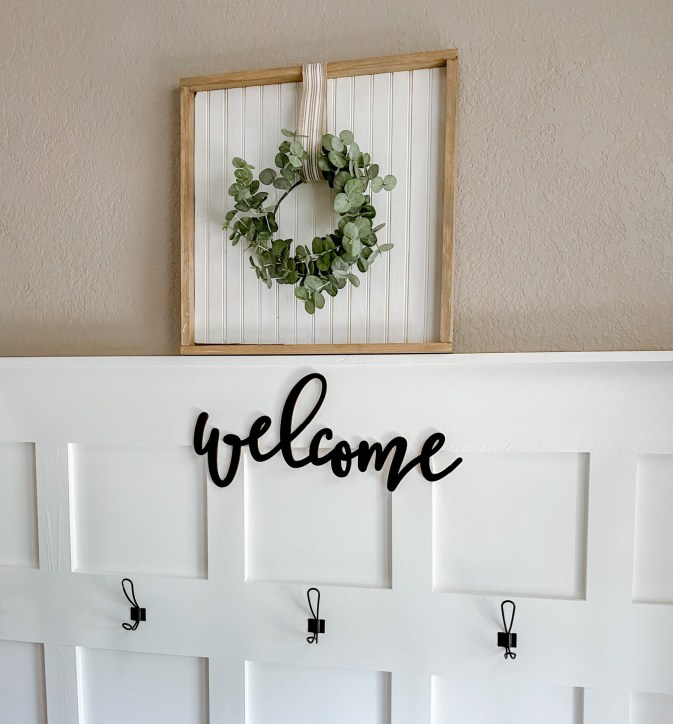 Learn how to recreate this beautiful farmhouse wreath sign using scrapbook wood and easy to nail trim and a wreath. This tutorial explains hows to use a scrap piece of wood for you to create this look in your home.