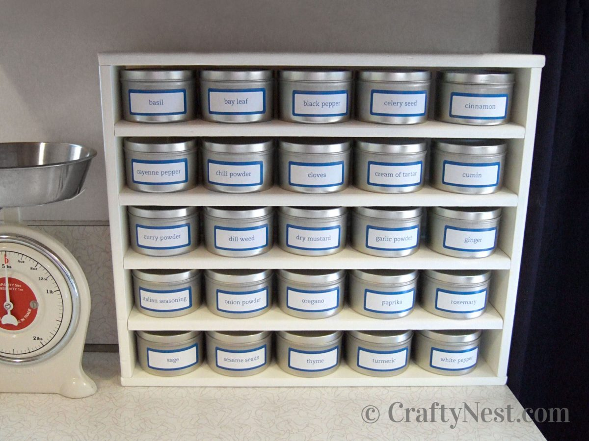 White spice rack with 25 seamless tins, photo