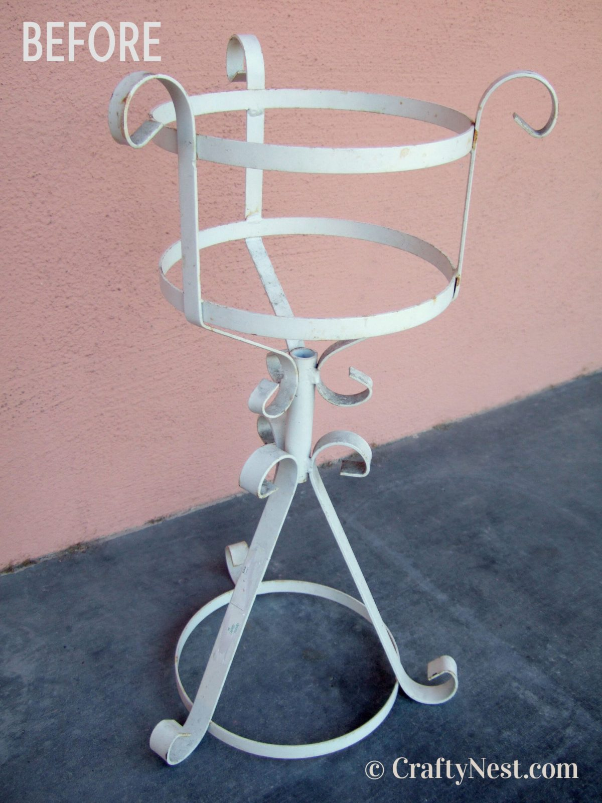 Rusty old metal plant stand, photo