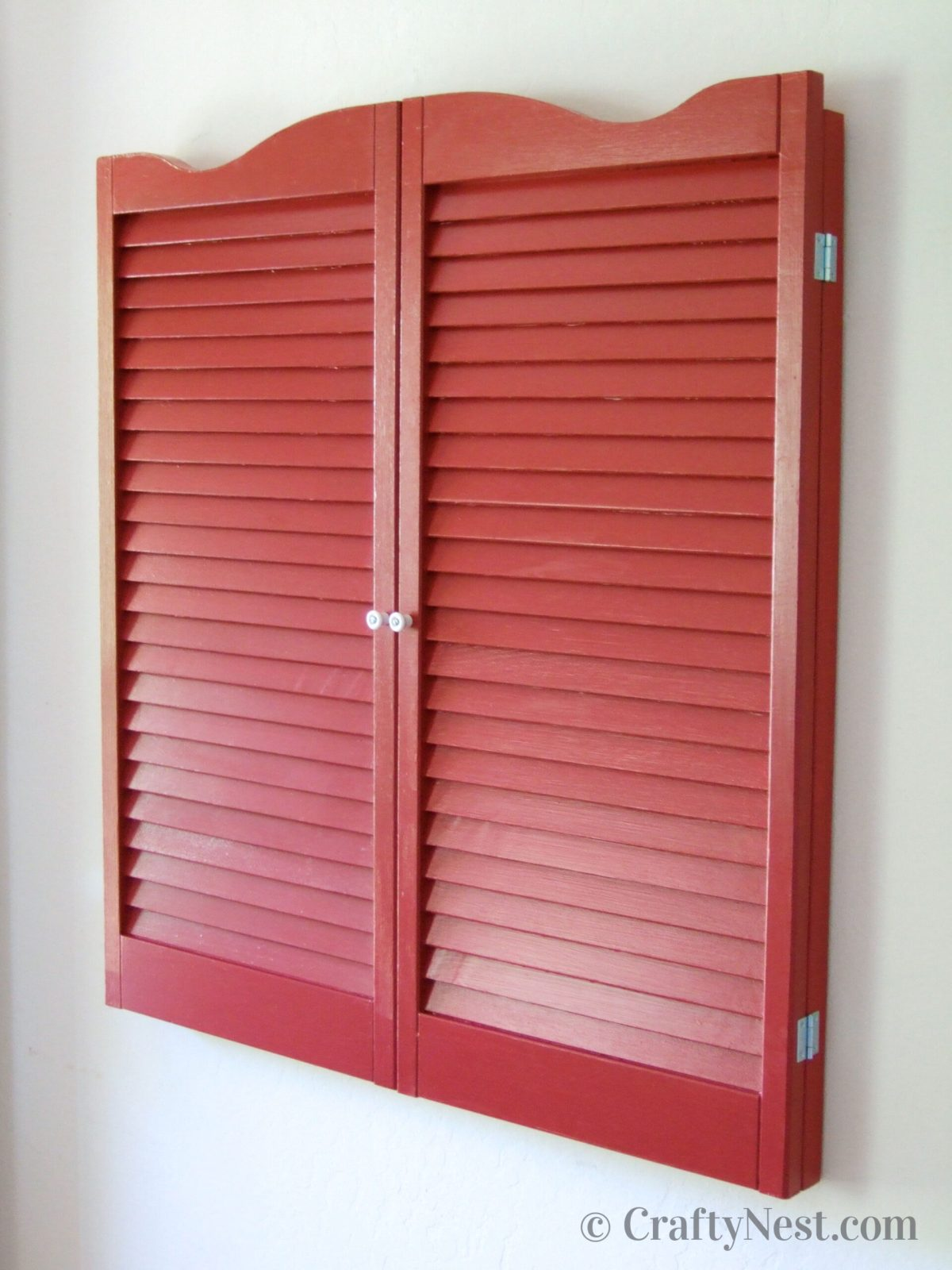 Red shutters covering a bulletin board, photo