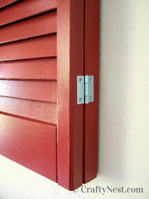 Hinge mounted on frame/shutter, photo
