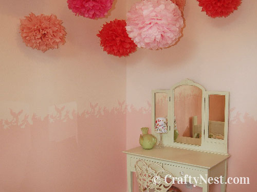 Vanity with stenciled wall and tissue-paper flowers, photo